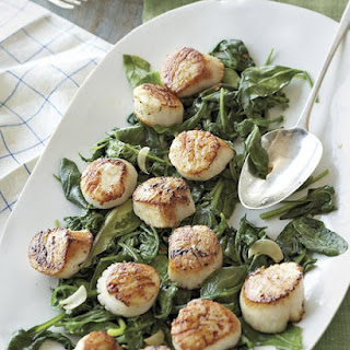 Scallops with Wilted Spinach and Arugula.