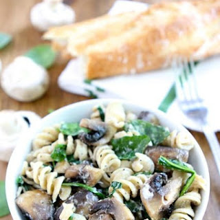 Creamy Goat Cheese Pasta with Spinach and Roasted Mushrooms.