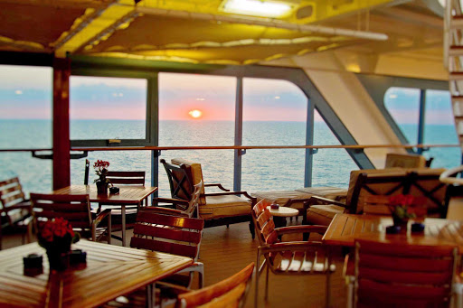 Azamara-sunset - Watch the sun set while enjoying a bite on your Azamara cruise.