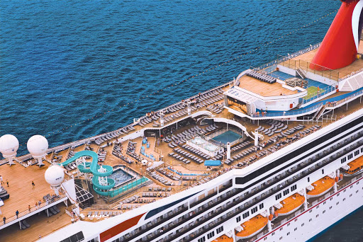 Carnival-Freedom-deck-pools - Whether you like to lounge on a deck chair or shoot down water slides, you won't be bored on a Carnival Freedom cruise.
