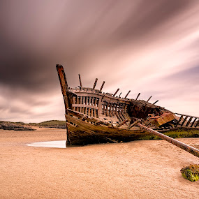 Old Shipwreck on Bunbeg Beach   by Peter Krocka - Transportation Boats ( ireland, shipwreck, sunset, beach, , Beach, blue, water, ocean. , storm, stormy, weather )