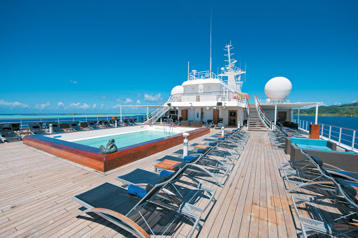 The pool deck aboard the Paul Gauguin offers sweeping views, ample seating and a pool bar.