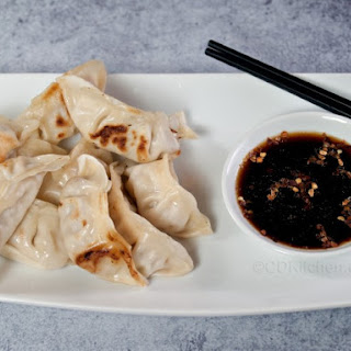 Pork Dumplings (Gyoza) With Dipping Sauce.
