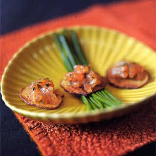 Salmon Gravlax Tartare on Crisp Potato Slices.