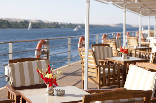 Uniworld-River-Tosca-sundeck-tables - The River Tosca sundeck is the ideal place for you to relax, enjoy al fresco dining and appreciate the natural wonders of Egypt's Nile.