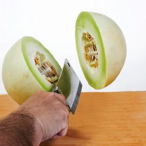 Melon Chop by George Holt - Food & Drink Fruits & Vegetables ( stop action, cleaver, freeze frame, fruit, melon, honeydew, chop )