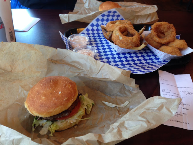 Regular Hamburger with Onion Rings and order of half Onion Rings/ half French Fries