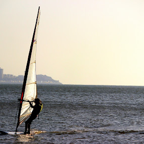 All alone in the Blue Sea by Neel Gengje - Sports & Fitness Watersports ( water, mumbai, surfing, sunset, horizon )