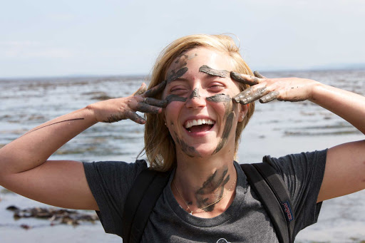 A woman hiker gets a little closer to nature in Bas-Saint-Laurent, Quebec, Canada