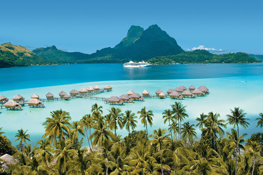 Bora_Bora_bungalows_Paul_Gauguin - Spectacular Bora Bora: Built to navigate the narrow inlets of French Polynesia, the Paul Gauguin can maneuver from open ocean to shallow lagoon as nimbly as a yacht.