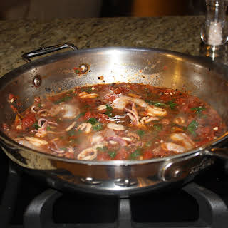 Braised Calamari with Spinach and Tomatoes.