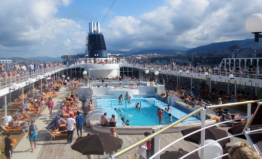 The pool deck during a busy afternoon on MSC Opera.