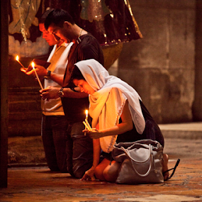 Prayer at the Holy Sepulcher by Yeshaya Dinerstein - Public Holidays Christmas ( candle, prayer, christians, jerusalem, church, holy sepulchre, churches, candles, holy places, holy, israel, holy land,  )