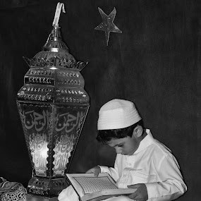 Reading Holy Book by Ahmed Yousry - Black & White Portraits & People ( reading, black and white, bw, holy book, kid )