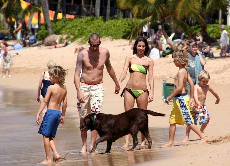The scene along Kaanapali Beach, a 3-mile stretch of sun, white sand and family fun on the western shore of Maui.