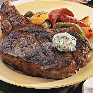 Rib-Eye Steaks with Bell Peppers and Gorgonzola Butter