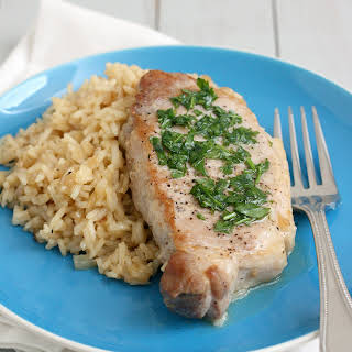 Skillet Pork Chops and Rice with Parsley Butter.