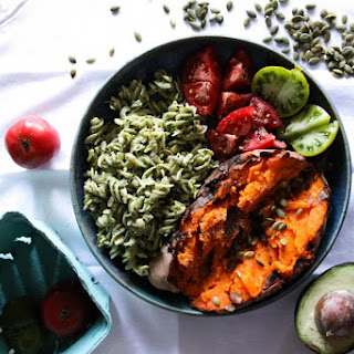 Baked Sweet Potato With Pesto Pasta, Tomatoes and Pumpkin Seeds