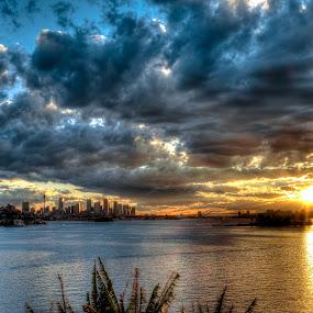 Stormy Sunset by Brent McKee - Landscapes Sunsets & Sunrises ( sydney harbour bridge, sunset, harbour, storm clouds, city skyline )