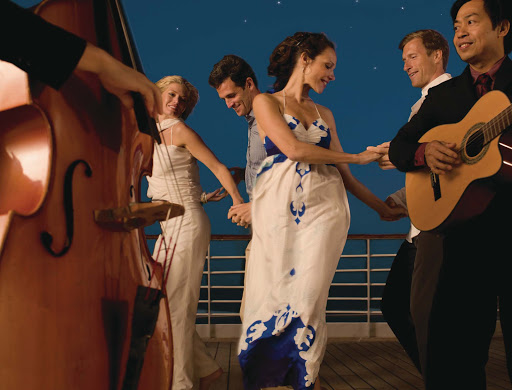 Sway to the music and feel the sea breeze while dancing on the deck of Seabourn Sojourn.