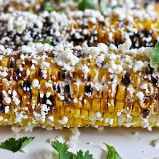 Grilled Corn with Bacon Butter and Cotija Cheese.
