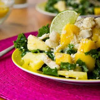 Tropical Mango, Banana, & Pineapple Kale Salad with Creamy Pineapple Lime Coconut Dressing.