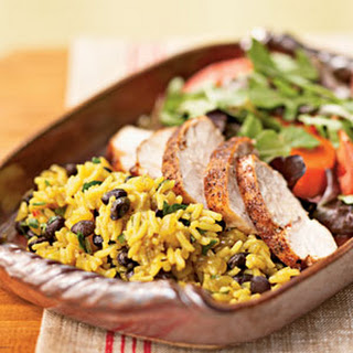 Jerk-Seasoned Turkey with Black Beans and Yellow Rice.