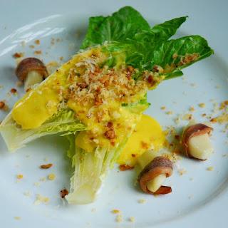 Caesar Salad with Anchovy Wrapped Garlic and Savory Lemon Sabayon.