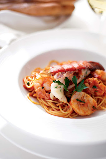 Indulge on lobster pasta during your Crystal Serenity voyage.
