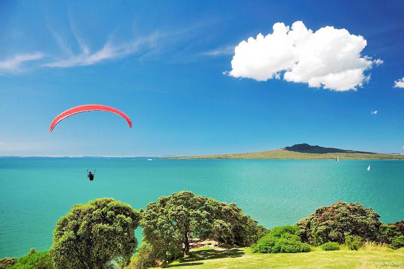 A parasailer explores the islands of Auckland's Hauraki Gulf Marine Park in New Zealand.