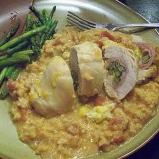 Stuffed Chicken Breasts with Asparagus and Parmesan Rice.
