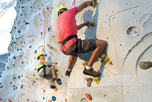 Voyager-of-the-Seas-rock-wall - Ever feel like climbing the walls? Rock wall climbing is one of the many fun family activities to try on Voyager of the Seas.