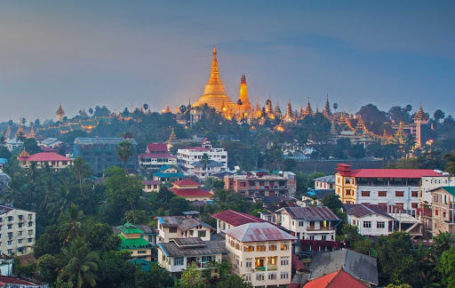 "Yangon-cityscape-Myanmar -  Yangon (formerly Rangoon, for ""End of Strife"") is Myanmar's largest city with a population of more than 5 million. See the Garden City of the East on a luxury river cruise aboard the AmaPura."