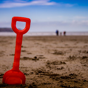red spade in the sane by Barrington Dent - Landscapes Beaches ( sand, red, beach, seaside, spade,  )