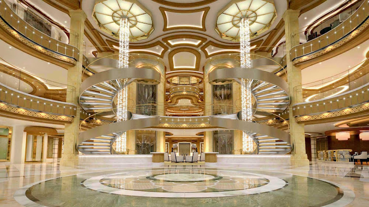 Royal Princess' large piazza-style atrium, seen from deck 5, features spiral staircases, dining options that include Gelato and the Ocean Terrace Seafood Bar, and live entertainment from the nearby bar or lounge.