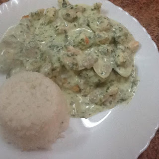 Chicken Breast With Clams, Prawns And Spinach In A Cream And Cream Cheese Sauce, Served With Boiled Rice.