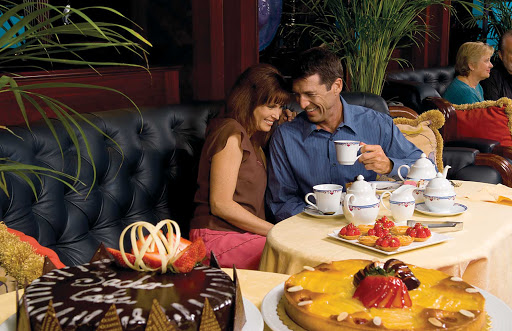 Travel on Oceania Nautica and enjoy a relaxing, intimate afternoon tea steps away from panoramic views.