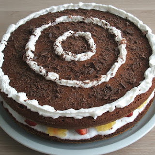 Chocolate Cake With Fruit And Whipped Cream.