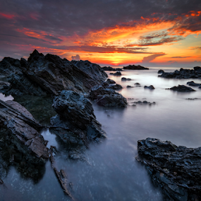 Sunrise at Pantai Pandak by Nur Ismail Mohammed - Landscapes Beaches ( reflection, epic, rocky beach, terengganu, long exposure, sunrise, rock formation )