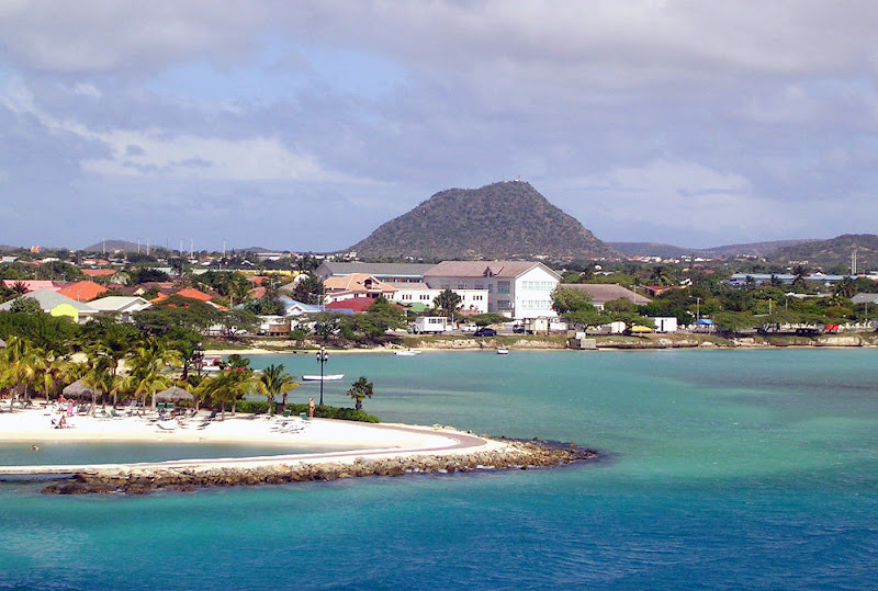 A seaside slice of Oranjestad, Aruba's main port, with the volcanic formation Hooiberg (