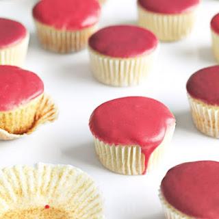 Vanilla Cupcakes with Fruit Glaze.