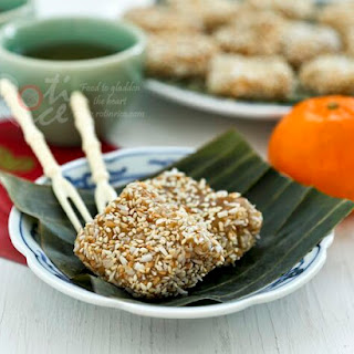 Steamed Nian Gao with Grated Coconut and Sesame Seeds.