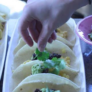 Individual Huevos Rancheros with Chipotle Black Beans and Creamy Avocado.