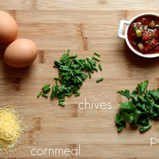 Savory Cornmeal and Chive Waffles with salsa and eggs.