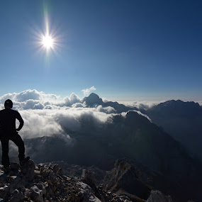 Taking a break by Zoran Stanko - Landscapes Mountains & Hills ( clouds, climb, mountain, awesome, fog, hiker, landscape, mist, alps )