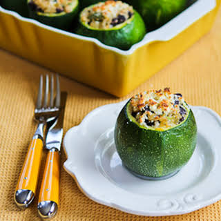 Vegetarian Stuffed Zucchini with Brown Rice, Black Beans, Chiles, Cheddar, and Cotija Cheese.