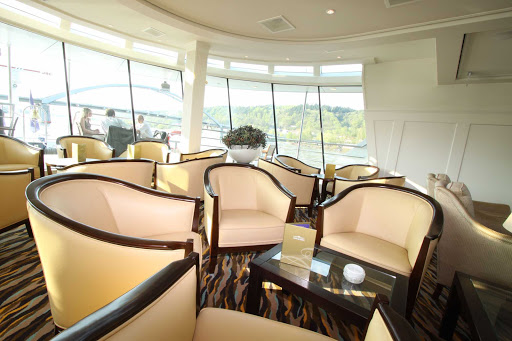 Relax in AmaLyra's spacious Panoramic Lounge and watch the passing vistas on your luxury river cruise of Europe.