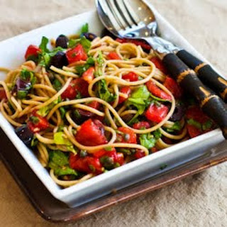 Recipe for Whole Wheat Spaghetti with No-Cook Sauce of Tomatoes, Arugula, Olives, and Capers.