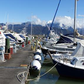 A winter morning on the Italian coasts by Francesco Altamura - Transportation Boats ( port, boating, mountains, winter, sunny, boats, sea, marina, transportation, river )