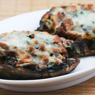 Grilled Portobello Mushrooms Stuffed with Sausage, Spinach, and Cheese.